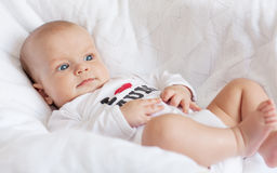 Cute newborn boy smiling Stock Images