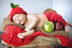 Cute newborn child sleeping on a soft blanket Royalty Free Stock Photos