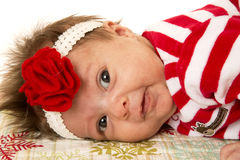 Cute newborn girl laying down with flower headband Royalty Free Stock Photography