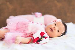 Cute Newborn girl with miniature Santa suit royalty free stock image