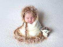 Cute newborn in hedgehog costume Royalty Free Stock Photography