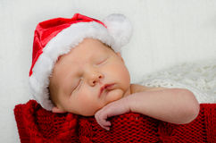 Cute newborn infant wearing santa hat for christmas Stock Photos
