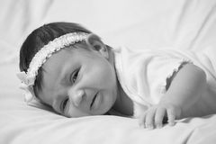 Cute newborn laying on her side Royalty Free Stock Photos