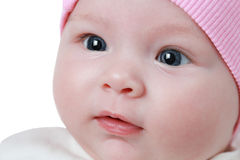 A cute newborn little baby girl with blue eyes Stock Photography