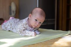 A cute newborn little baby girl with blue eyes Royalty Free Stock Images