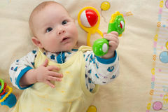 A cute newborn little baby girl with  toy. Royalty Free Stock Photography