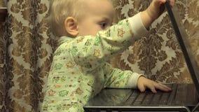 Cute Newborn Little Girl Works Personal Computer. 4K UltraHD, UHD stock video footage