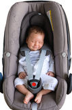 Cute newborn smiling in car seat Royalty Free Stock Image