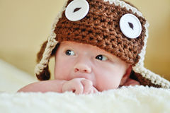 Cute newborn wearing funny hat Royalty Free Stock Photos