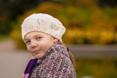 Cute nice girl in white beret smiling Royalty Free Stock Photo