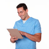 Cute nurse guy working with his tablet pc Royalty Free Stock Images