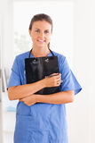 Cute nurse holding a folder Stock Photography