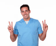 Cute nurse man with victory sign Royalty Free Stock Photo