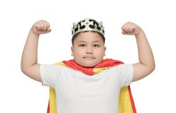 Cute obese boy is showing muscle; isolated. On the white background background with copy space for input text Royalty Free Stock Photo