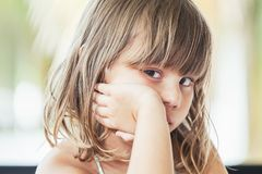 Cute offended Caucasian little girl, close-up Stock Images