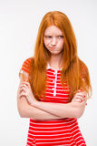 Cute offended girl standing with hands crossed Royalty Free Stock Photo