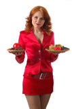 Cute officiant. Woman in red with lot's of food, isolated on white Royalty Free Stock Photography
