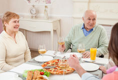 Cute old people are dining with their relatives Royalty Free Stock Photo
