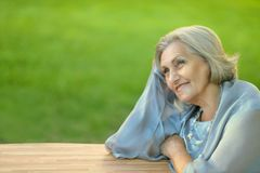 Cute old woman outdoors Stock Photo