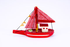 Cute old wooden red fishing boat isolated Royalty Free Stock Photos