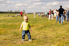 Cute one year boy on the lawn on the summer fest.  Royalty Free Stock Image