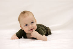 Cute open-mouthed 9-month-old toddler looking away Stock Photos
