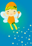 Cute orange firefly fairy. With her magic wand flaying on a blue background leaving a stray of magic shiny stars Royalty Free Stock Photo