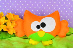 Cute orange owl. Handmade toy for children. Kids sewing crafts. Needlework idea Stock Photos