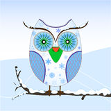 Cute owl on a branch in winter Royalty Free Stock Image