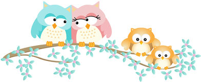 Cute owl family on spring tree branch Royalty Free Stock Photos