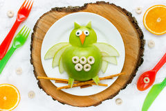 Cute owl from green apple Royalty Free Stock Photo