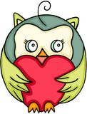 Cute owl holding a red heart Royalty Free Stock Photos