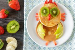 Funny homemade breakfast with pancakes and fruits. Cute owl made from  pancakes with fruits for kids breakfast Royalty Free Stock Image