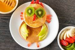 Funny homemade breakfast with pancakes and fruits. Cute owl made from  pancakes with fruits for kids breakfast Stock Photo