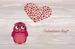Cute owlet dreams of love. Owl looks at the heart top. Greeting. Card for Valentine`s Day. Empty space for your text or advertisement. Vector illustration on Stock Images
