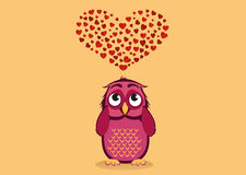 Cute owlet dreams of love. Owl looks at the heart top. Greeting Stock Photography