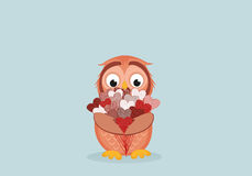 Cute owlet waiting to give a  of flowers of hearts as a gift Royalty Free Stock Photo