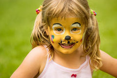 Cute painted face. Little girl with a painted face Stock Photography