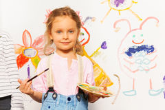 Cute painter with brush and pallet drawing picture Stock Image