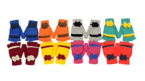 Cute pairs of gloves arranged in a line. Stock Photos