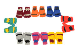 Cute pairs of gloves arranged in a rectangle. Royalty Free Stock Image