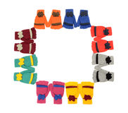 Cute pairs of gloves arranged in a square. Stock Photo