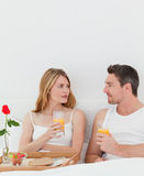 Cute pairs having breakfast Stock Image