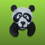 Cute Panda Head in Green Background. Editable vector illustration of a cute panda bear head in green background. Plasticine modeling Stock Images