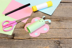Cute paper butterfly crafts, scissors, marker, glue stick, colored paper set, pencil on old wooden table. Kids working place. Summer preschooler art craft and stock images