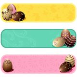 Cute pastel colored easter banners. Set of three cheery banners with chocolate eggs. Graphics are grouped and in several layers for easy editing. The file can be stock illustration