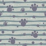 Cute Pattern with colorful dog paws on beige background with tiny dots. Hand Drawn Design. Great for wall art design, gift paper, Royalty Free Stock Image