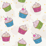 Cute pattern with cupcakes. Vector seamless pattern with colorful cupcakes, birthday wrapping paper Royalty Free Stock Photo