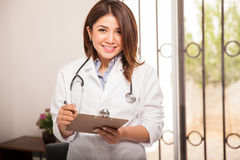 Cute pediatrician at work Royalty Free Stock Photography