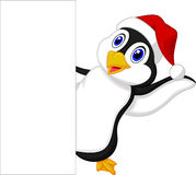 Cute penguin cartoon with red hat waving Stock Photo